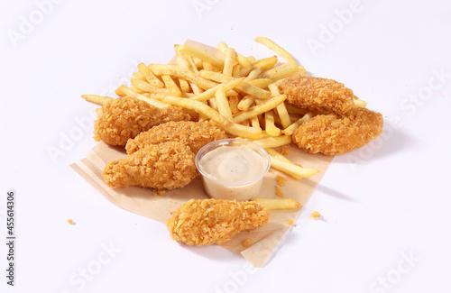 chicken wings with sauce and french fries
