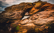 Donut Shaped Giant Sea Rock Formations On The Beavertail State Park In Rhode Island