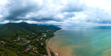 Aerial Drone Landscape Of The Sea Coast Near Forested Mountains On A Rainy Summer Day. The Sea Water Is Muddy And Dirty Due To Rain Streams Flowing Down From The Mountains