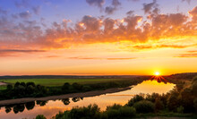 Scenic View At Beautiful Summer River Sunset With Reflection On Water With Green Bushes, Calm Water ,deep Colorful Cloudy Sky And Glow On Horizon On A Background, Spring Evening Landscape
