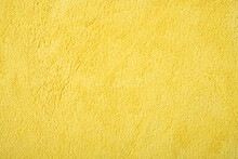 Yellow Fluffy Cloth For Cleaning As Background And Texture