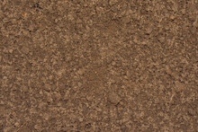 Background Image Of Ground And Sand Close-up. Brown, Wet Soil.