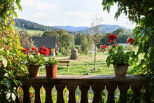 A Beautiful Rural Mountain Landscape Seen From The Wooden Porch Of Old House.