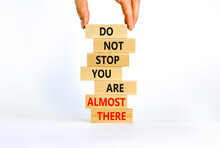 You Are Almost There Symbol. Wooden Blocks With Words 'do Not Stop You Are Almost There'. Businessman Hand. Beautiful White Background, Copy Space. Business, Motivation And Almost There Concept.