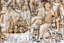 Close-up On Decorative Sculptures Engraved On A Marble Wall Representing An Ancient Roman Battle Scene In A Coastal Town