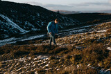 Man Hiking on Snowy Mountain