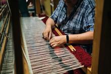 Craftsman Hands Working Over The Warp