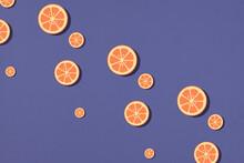 Orange Sliced From Paper Pattern On Purple Background
