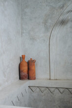 Clay Jugs Against The Concrete Wall In The Room