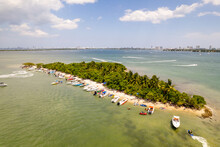 Aerial Photo People Vacationing On An Island With Boats And Waverunners