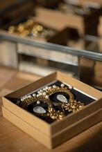 Bohemian Earrings In A Box On A Table