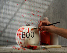 Decorating Pumpkin With Red Paint At Home