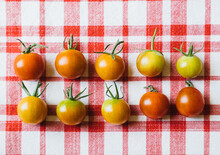 Multicolored Tomatoes On Red Pattern Background