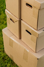 Carton Boxes On Grassy Lawn