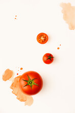 Creative Layout Made Of Tomato With Watercolor Spots On The White Background