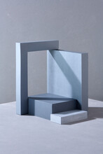 Cosmetic Display Stand With Stone Gate Background.