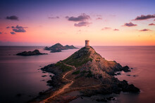 Sunset Over The Genoese Tower And Lighthouse At Pointe De La Parata And Les Iles Sanguinaires Near Ajaccio In Corsica