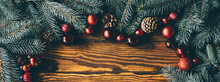 Christmas Tree Branches And Festive Decoration On Wooden Background.
