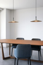 Luminous Empty Dining Room With Three Chairs And Two Lamps