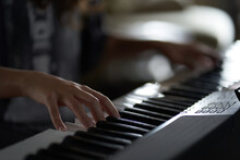 The Musician's Hands On The Synthesizer. A Cropped Image Of A Person Playing A Synthesizer. Side View. High Quality Photo
