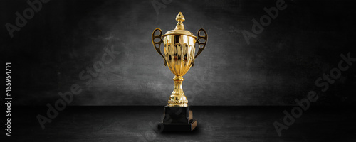 gold award and trophy in dark and black studio and showroom