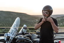 Mature Man With Sidecar In Sunset With Her Bike