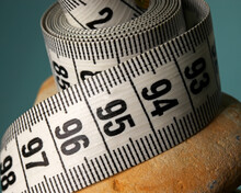 Diet Concept With Measuring Tape And Natural Stones