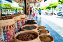 Assortment Of Turkish Spices And Herbs In Wooden Bowls. Turkish Market Spices Such As Saffron, Sumac And Thyme. Cumin, Rosemary And Isot.