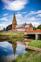 St Paul's Church, Fulney, Spalding, Lincolnshire, UK With Reflection In The Coronation Channel Against A Fair Weather Sky