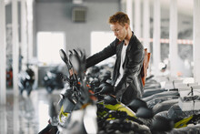 Handsome Man Choosing A Motorcycle To Buy