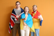 Young People With Different Flags Showing Thumb-up On Color Background