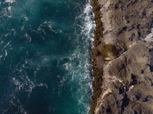 Seascape. Dark Turquoise Ocean Water With Light White Waves And Rocky Coast. Beauty Of Nature. View From Above. Drone Shooting. Ecology, Tourism, Recreation, The Greatness Of Nature.