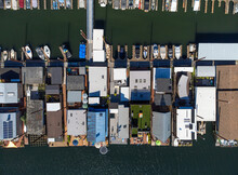 Many Small Houses By The Sea. Boat Pier. Boats, Yachts, Sailboats Are Moored At The Pier. There Are No People In The Photo. View From Above. Aerial Photograph.