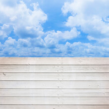 Old Weathered White Painted Wooden Slatted Wall With Cloudy Sky On Background