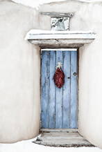 Traditional Chili Ristra Hangs On Door In Santa Fe, New Mexico