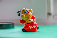Red Sculpture Of A Bee With A Heart. Gift For Valentine's Day And March 8