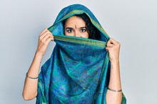 Young Indian Woman Wearing Sari Covering Head And Face, Doing Elegant Pose With Traditional Scarf