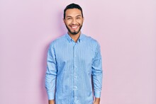Hispanic Man With Beard Wearing Casual Blue Shirt With A Happy And Cool Smile On Face. Lucky Person.