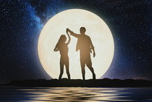 Couple Silhouette. Couple Concept. Couple Dancing On Hill With The Moon.Celebrate Mid-autumn Festival.