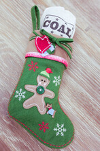 Holiday Stocking With Sack Of Coal