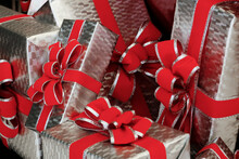 Silver Holiday Packages With Red Bows