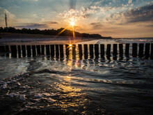 Baltic Seascape With Wooden Wave Breaker At Sunset