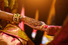 Bride Hand With Mehndi And Bangles On Groom Hand At Hindu Wedding Cere