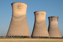 Three Of The Five Cooling Towers Of The Disused Willington Power Station, Derbyshire, England, UK.
