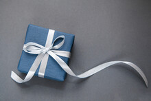 Dark Blue Gift Box On Grey Background. Gift For Men. Fathers Day. Present For Him.