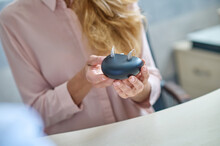 Modern Hearing Aids In Caring Female Hands