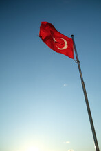 A Turkish Flag Waving In The Sky