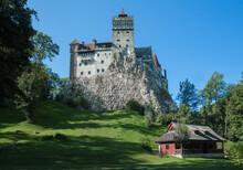 Bran Castle Exteriror Built High On Steep Rock Outcrop  Hill