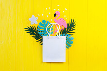 Mockup Summer Tropical Leavess With Flamingo Bird On Yellow Wooden Background. Jungle Palm And Monstera Leaves With Package Copyspace For Greeting Card