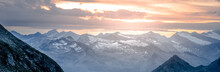 Rocky Alpine Mountains Morning Panorama. Cloudy Sunrise On Summer Day. Hohe Tauern National Park, Austrian Alps